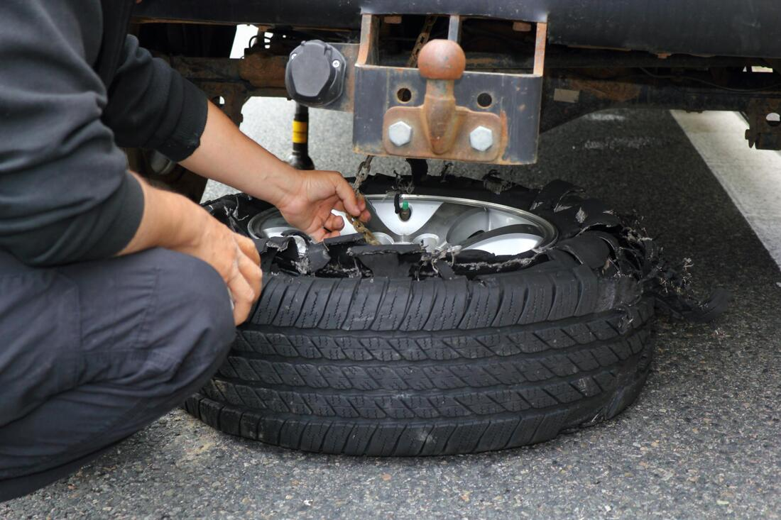 man fixing a tire